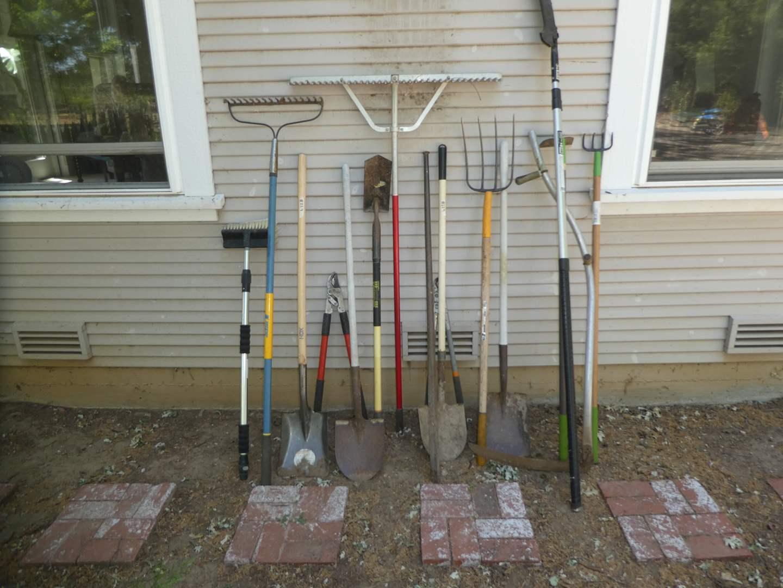 Lot # 229 - Lot of Yard Tools - Shovels, Pole Saw, Rake, Pruners, Sycthe and more (main image)