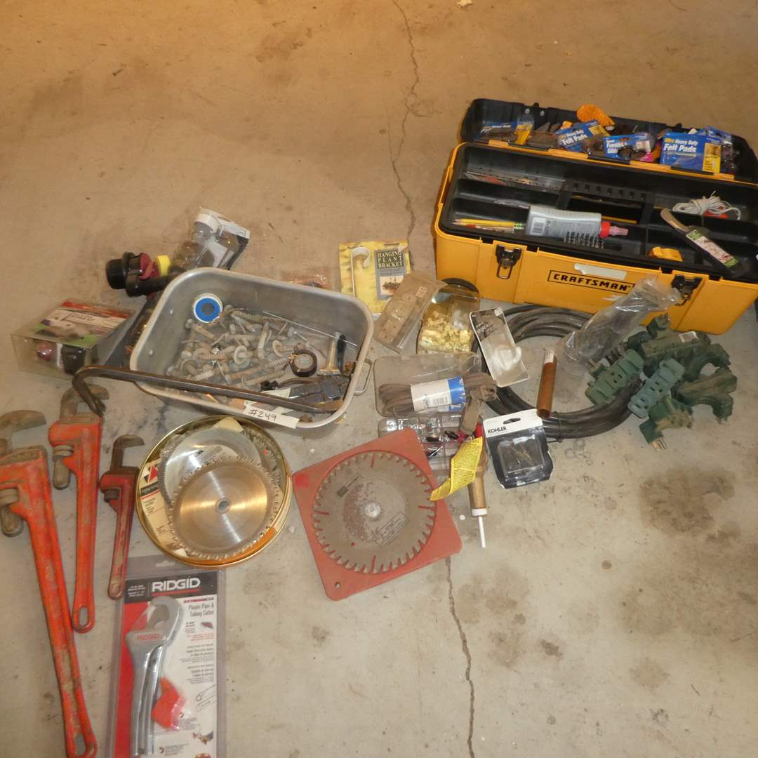 Lot # 249 -Variety Lot -Pipe Wrenches, Round Saw Blades, Craftsman Tool Box and Misc. Hardware