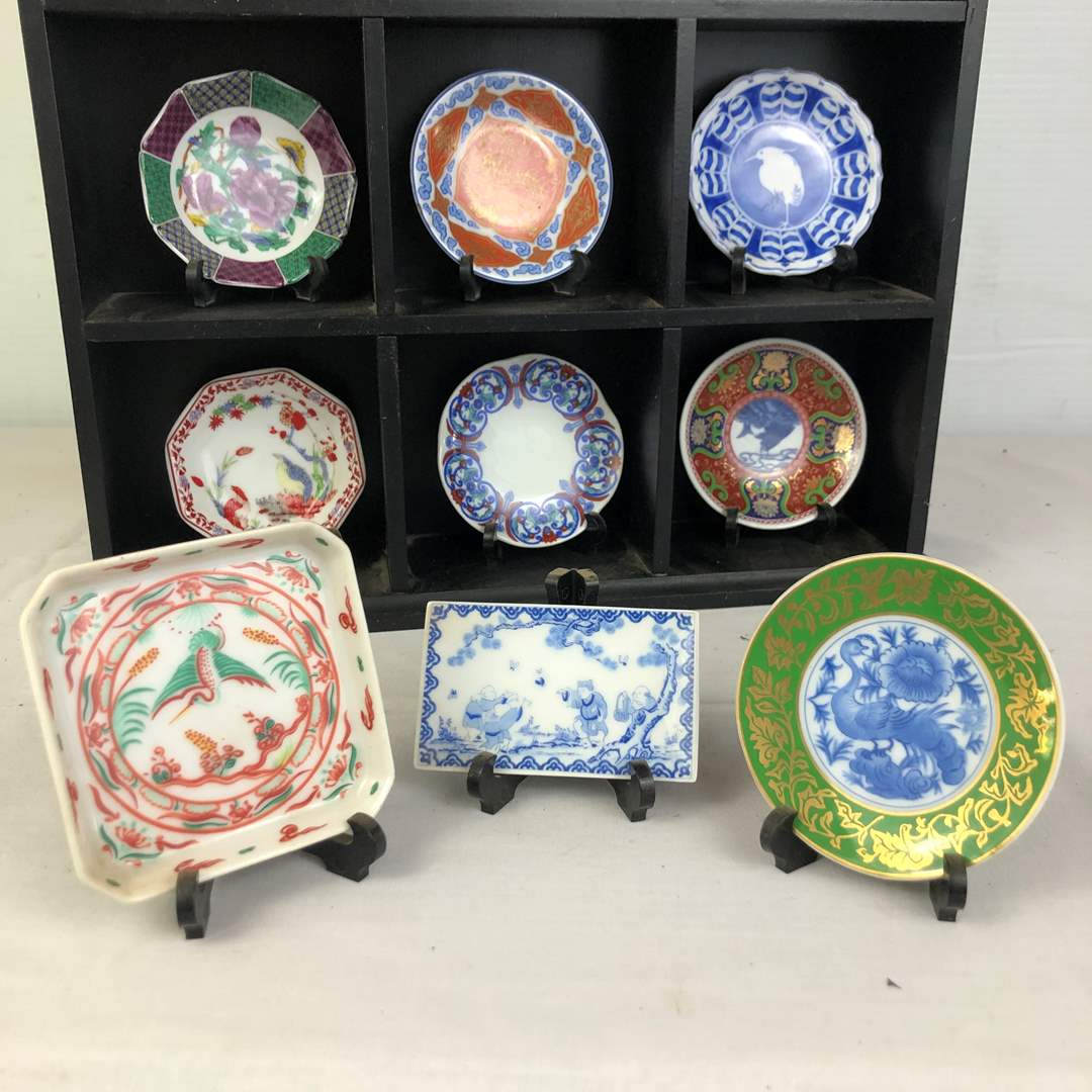 Lot # 116 - Lot of miniature Asian collector plates in display shelf (main image)
