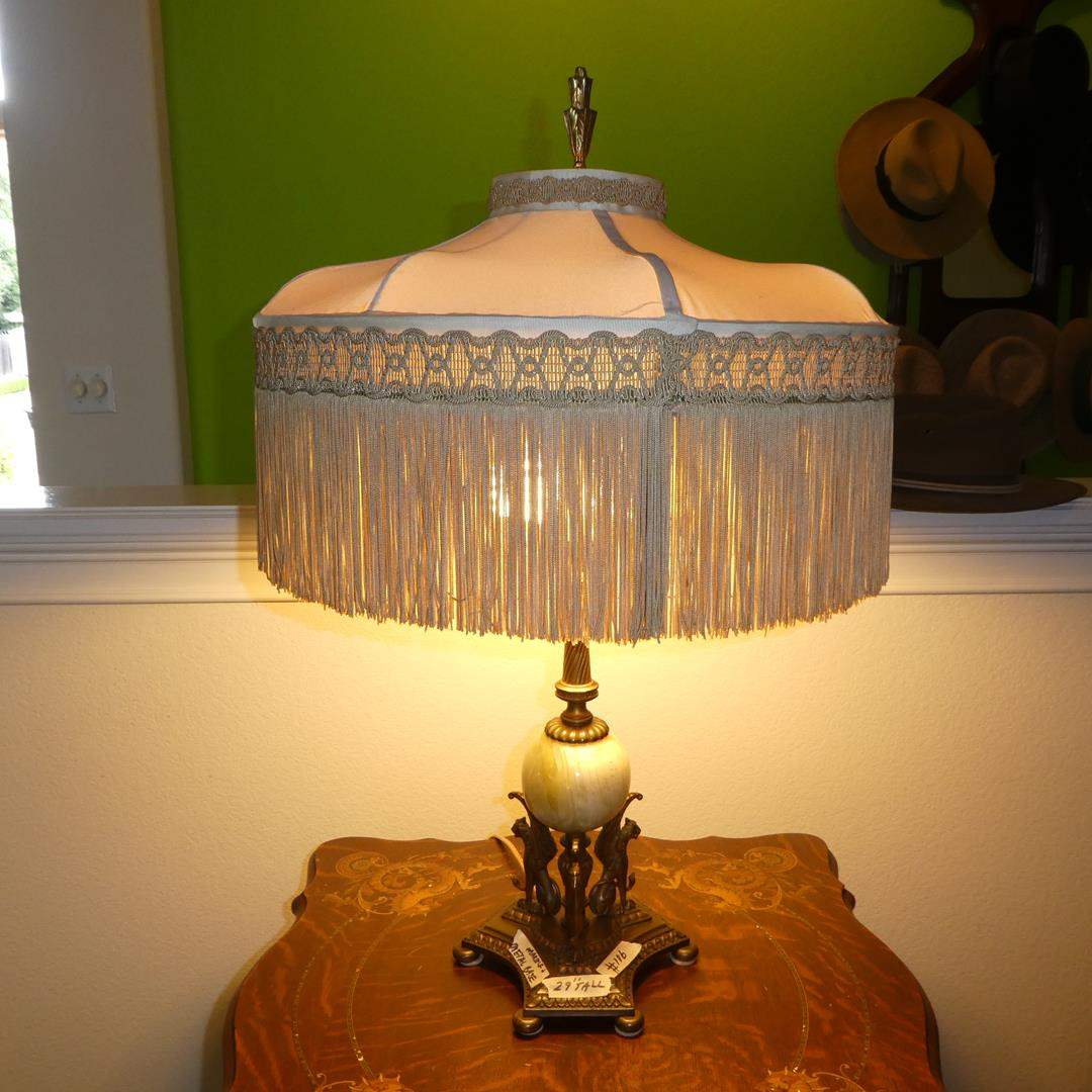 Lot # 106 - Vintage Winged Griffin Mythical Winged Lion Metal w/Marble Base & Beautiful Fringed Shade Table Lamp (main image)