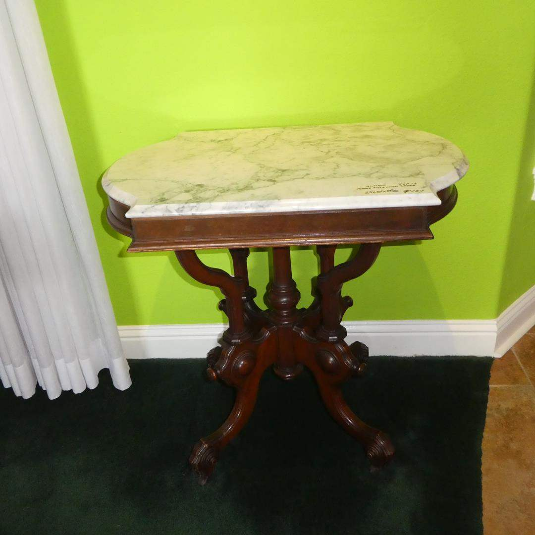 Lot # 107 - Antique Marble Top Parlor Table w/Intricate Wood Base on Casters (main image)