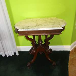 Lot # 107 - Antique Marble Top Parlor Table w/Intricate Wood Base on Casters