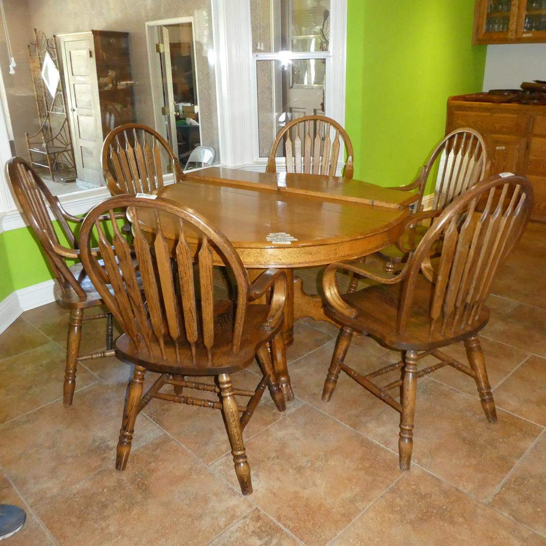 Lot # 140 - Vintage Oak Claw Foot Table w/One Leaf & Six Bent Wood Dining Chairs (main image)