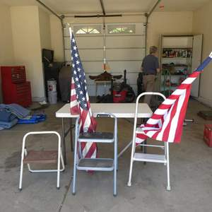 Lot # 613 - Three Folding Step Stools, Two American Flags & 4' Folding Table
