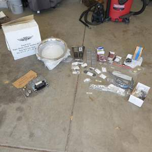 Lot # 620 - 1972 Ford Ranchero Radio, Window Cranks, Chrome Plated Stainless Steel Deep Dish Trim Rings & Misc. Corvette Parts