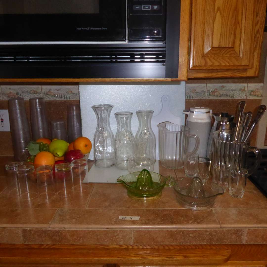 Lot # 4 - Vintage Glass Juicer Reamers, Glass Pitchers & Wine & Juice Decanters (main image)