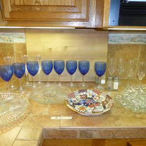 Lot # 34 - Blue Glass Stemware, Nice Wood Cutting Board & Serving Dishes