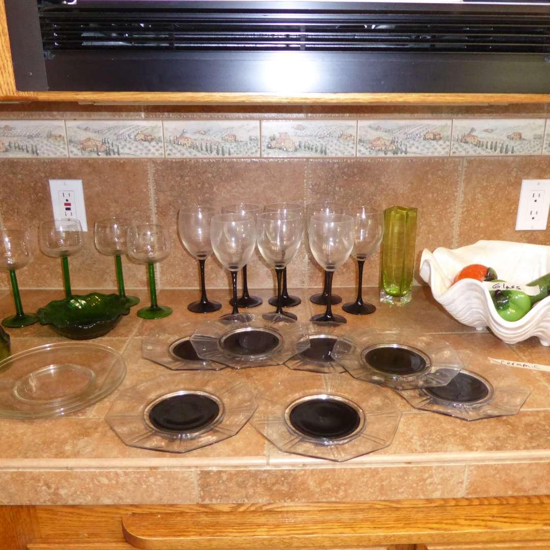 Lot # 39 -  Glass Fruit, Ceramic Shell, Black & Clear Plates & Stemware & Green Glasses (main image)