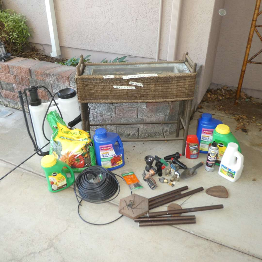 Lot # 451 - Gardening Supplies, Planter, Wind Chime, Sprinklers and More (See all Photos for Products) (main image)