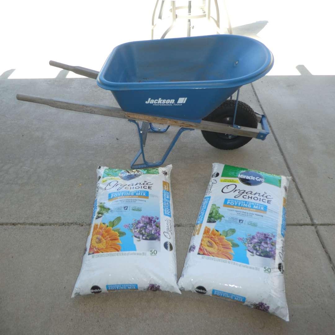 Lot # 452 - Jackson Professional Tools Wheelbarrow and Two Bags of Organic Choice Miracle Grow Potting Mix  (main image)