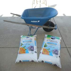 Lot # 452 - Jackson Professional Tools Wheelbarrow and Two Bags of Organic Choice Miracle Grow Potting Mix