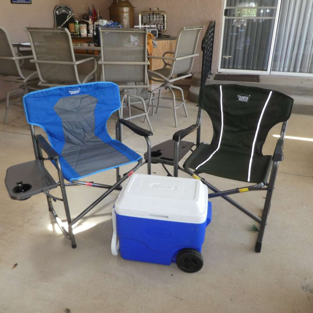 Lot # 454 -  Two Timber Ridge Foldable Camp Chairs (Director Style w/ Fold out Side Table) and Colman Wheeled Cooler  (main image)