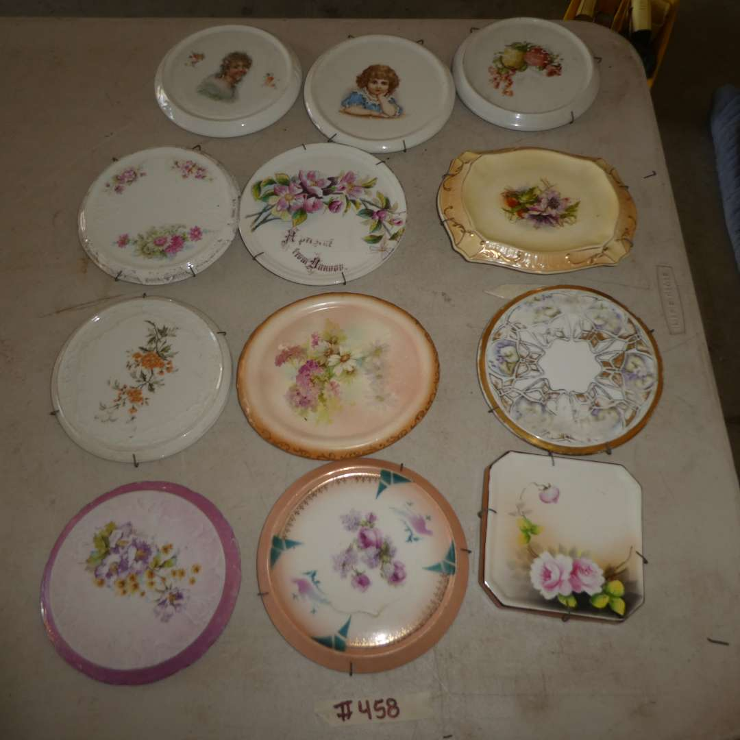 Lot # 458 - 12 Porcelain Decorative/Collectible Trivets   (main image)
