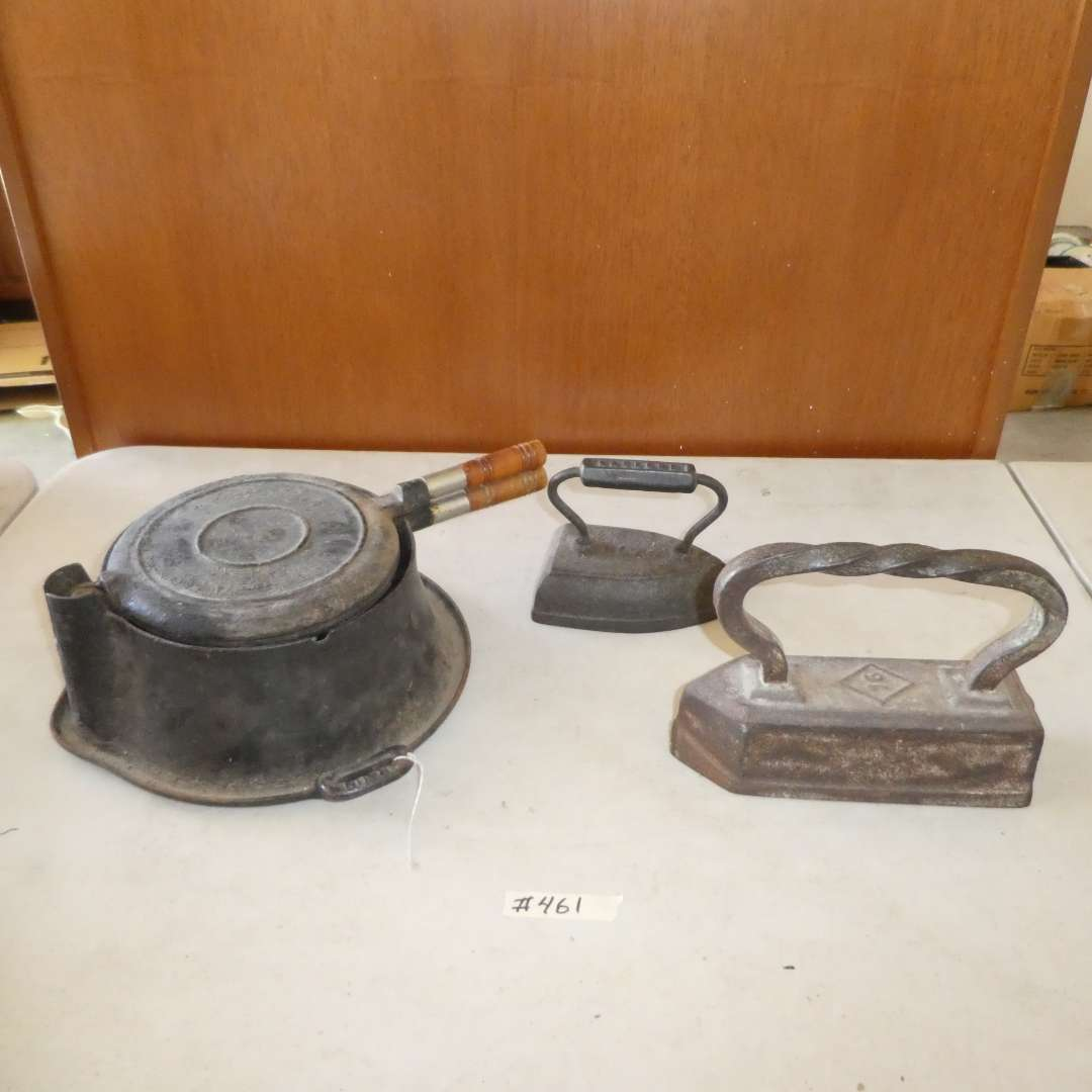 Lot # 461 - Two Vintage Cast Iron Irons and Vintage Griswold Cast Iron Waffle Maker  (main image)