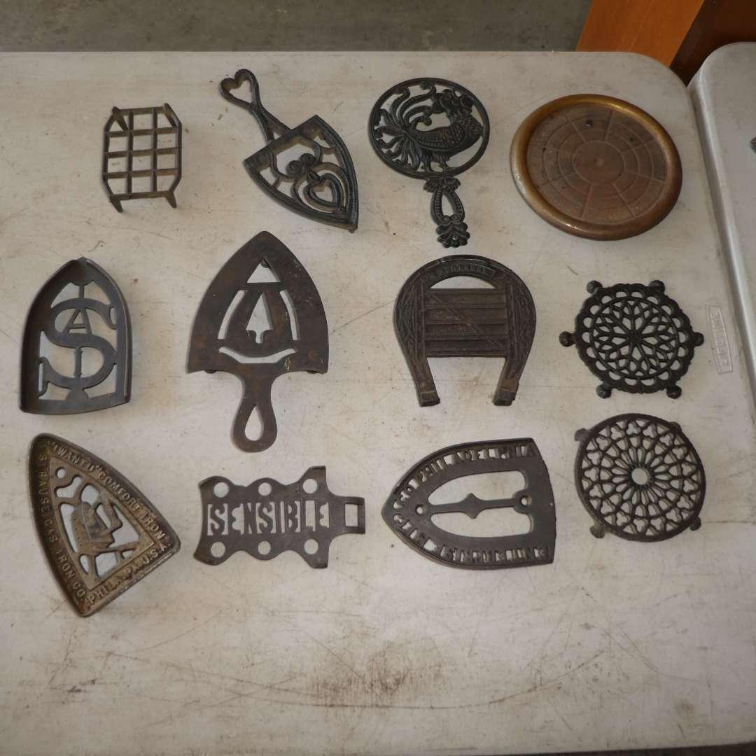 Lot # 464 - 12 Cast Iron Trivets  (main image)