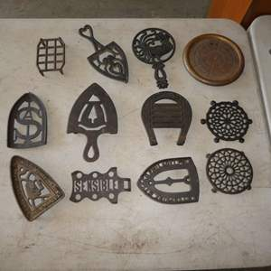 Lot # 464 - 12 Cast Iron Trivets