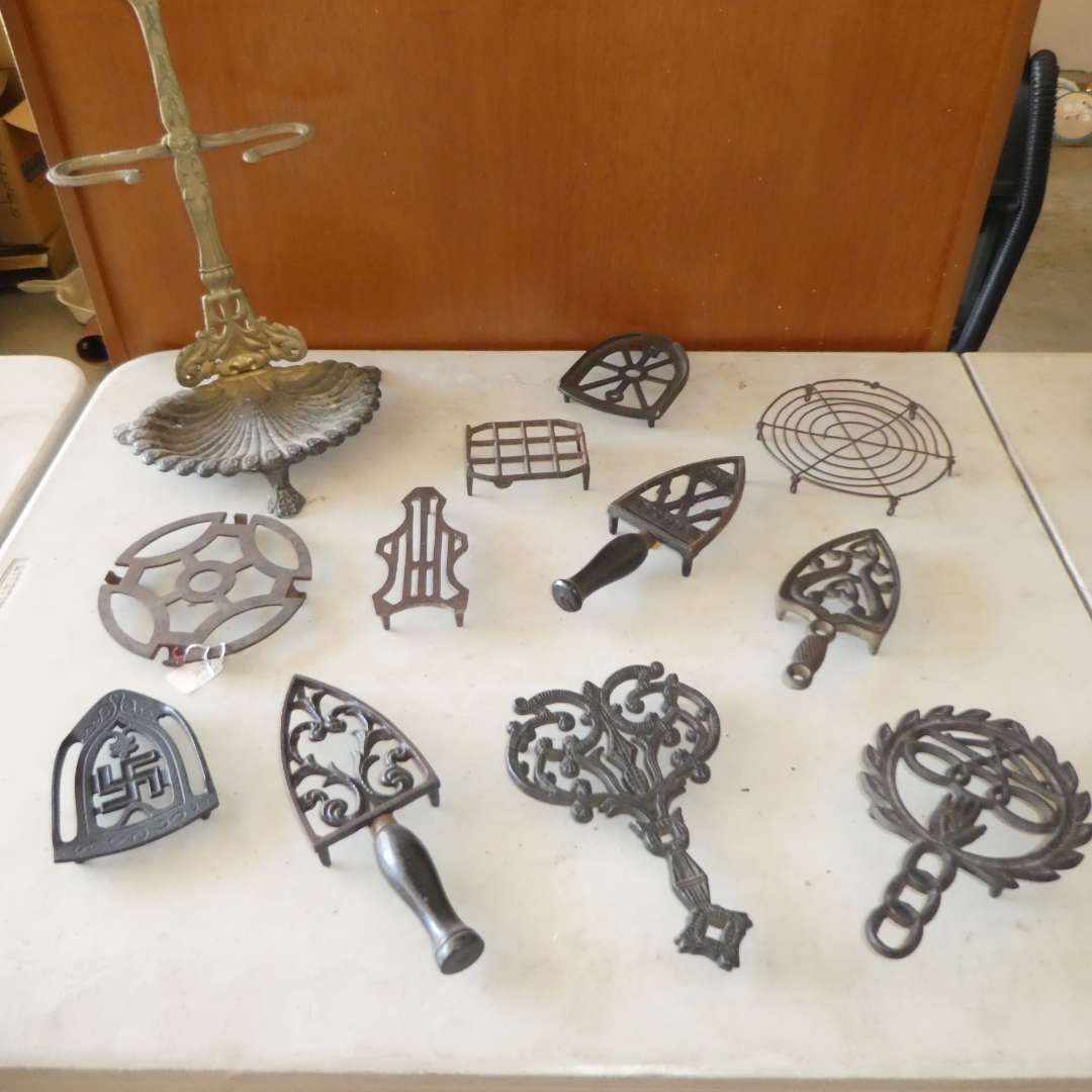 Lot # 465 - 10 Cast Iron Trivets (One Metal) and Fireplace Set Stand (main image)