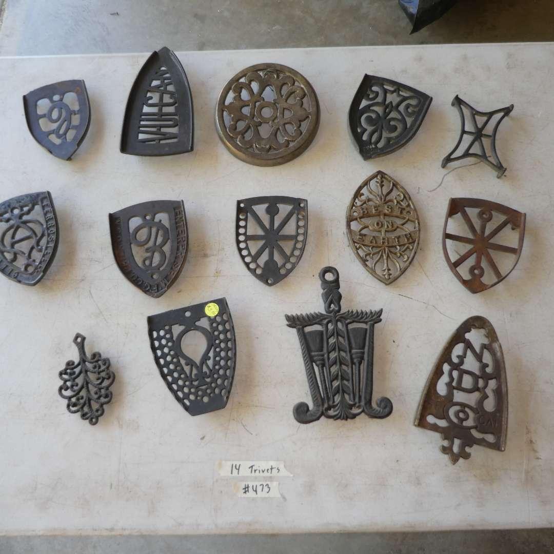 Lot # 473 - 14 Cast Iron Trivets (main image)