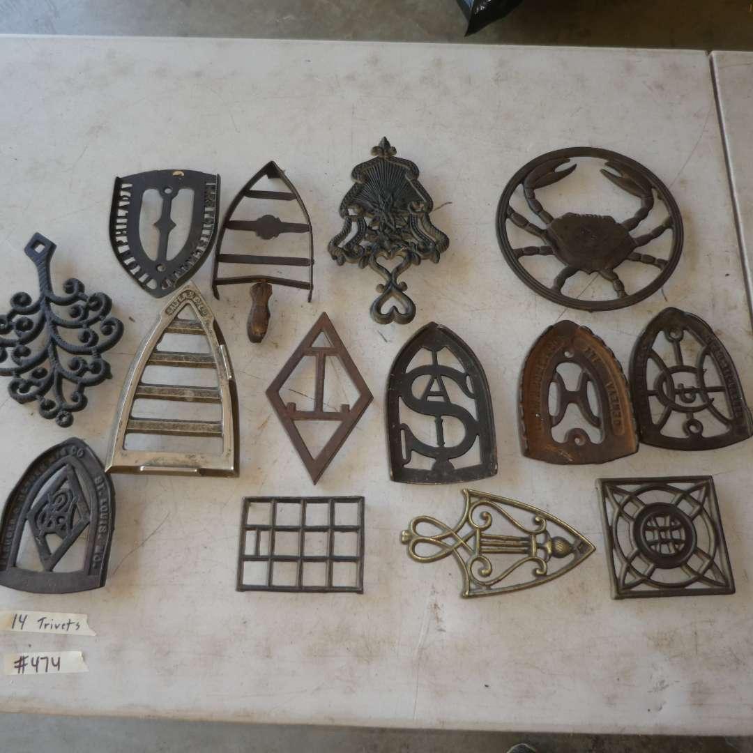 Lot # 474 - 14 Cast Iron Trivets (main image)