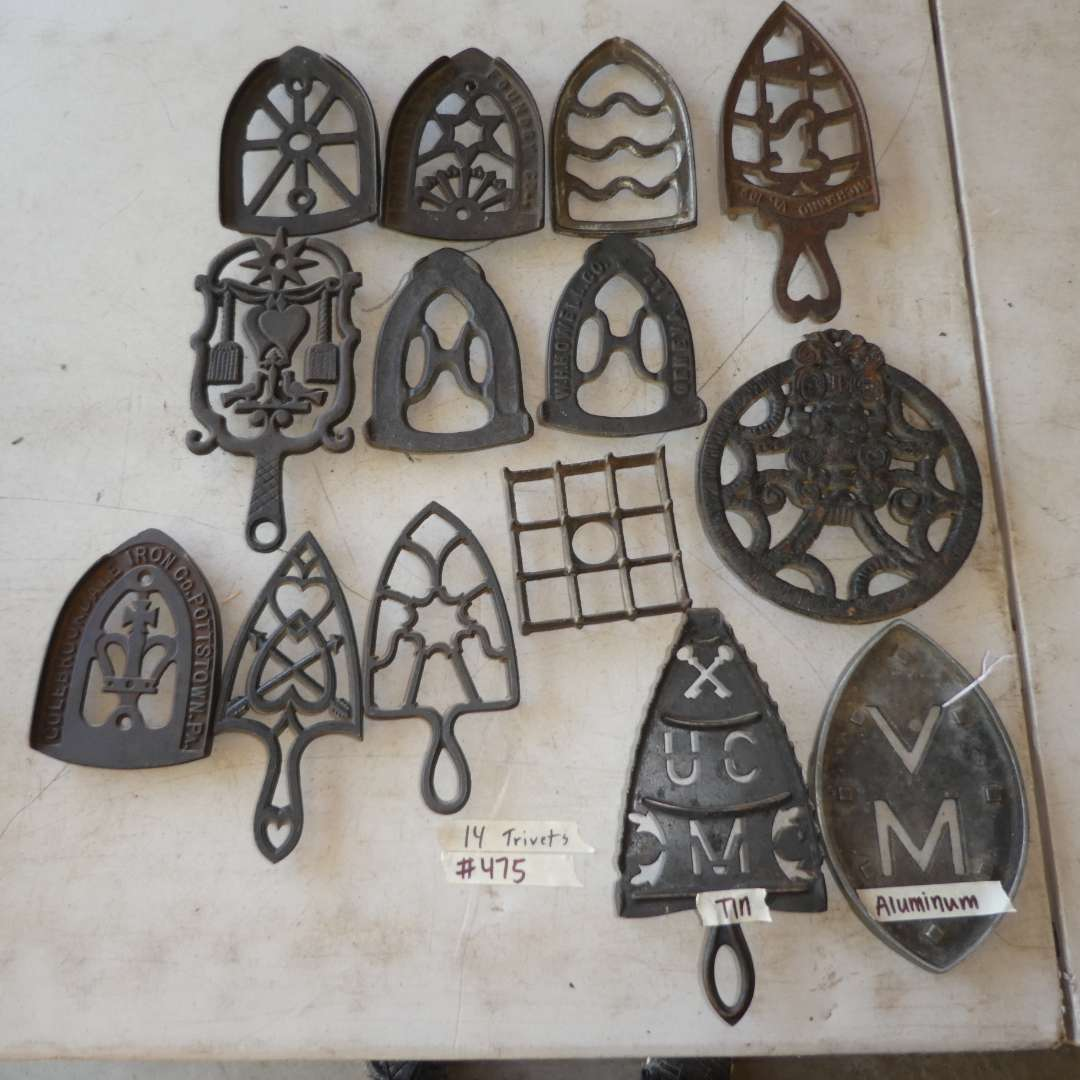 Lot # 475 - 12 Cast Iron Trivets, 1 Aluminum and 1 Tin