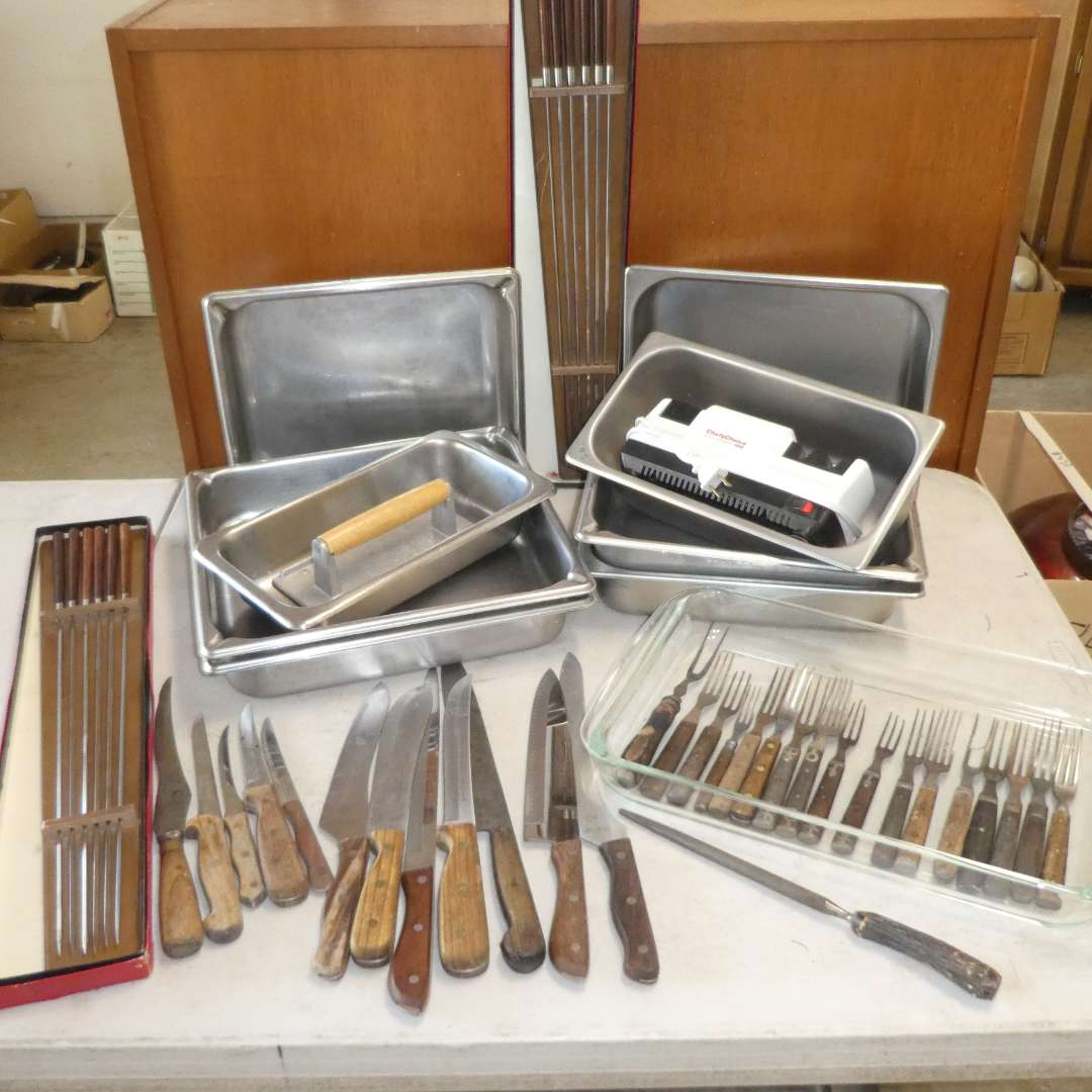 Lot # 476 - Stainless Steel Chaffing Pans, Knives, Electric Knife Sharpener, Pyrex Baking Dish and BBQing Skewers  (main image)