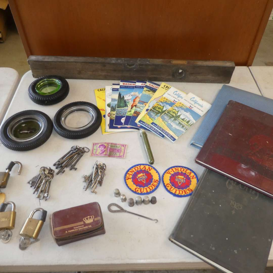 Lot # 489 -Vintage Year Books, Maps, Skeleton Keys, Thimbles, Poker Chips, Ash Trays and More  (main image)