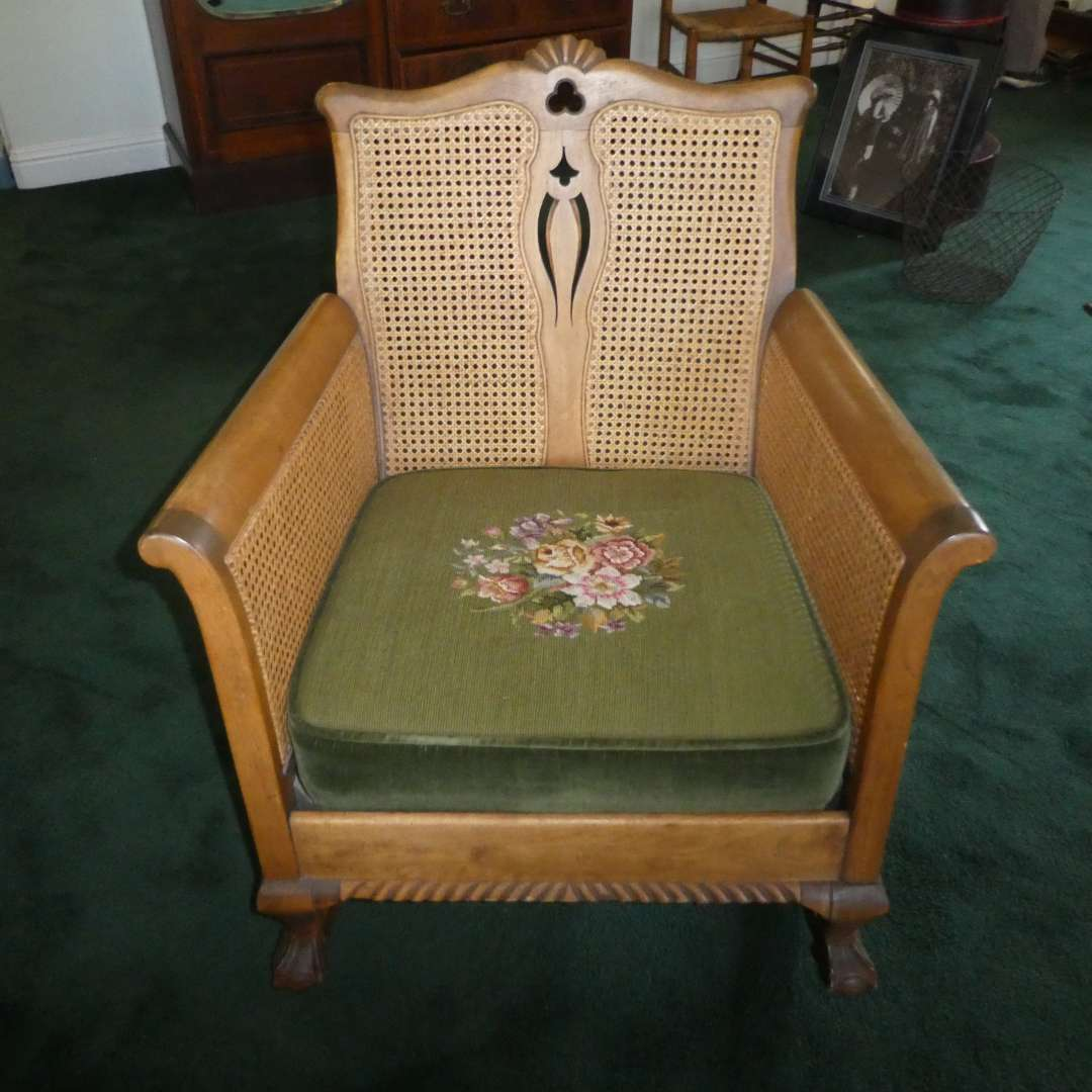 Lot # 204 - Antique/Vintage Wooden Rocking Chair w/Claw Feet, Cane Back &Needlepoint Seat  (main image)