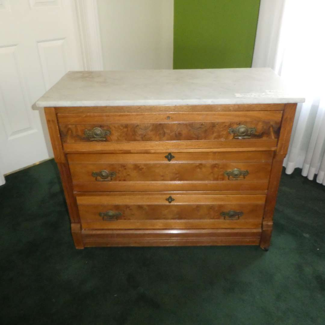 Lot # 210 - Antique Marble Top 3 Drawer Dresser on Casters (No Key) (main image)