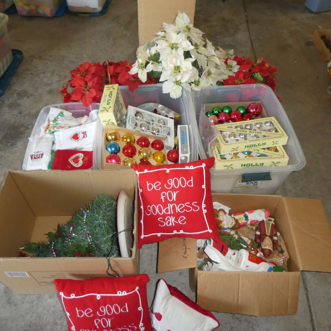 Lot # 496 - Christmas Lot--( Light Up Tree, Variety of Ornaments, Pillows and Artificial Poinsettia) (main image)