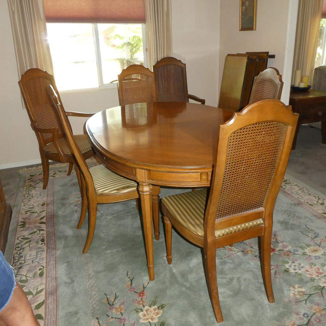 Lot # 100 - Vintage Drexel Furniture Dining Table w/Three Leaves & Six Cane Back Dining Chairs