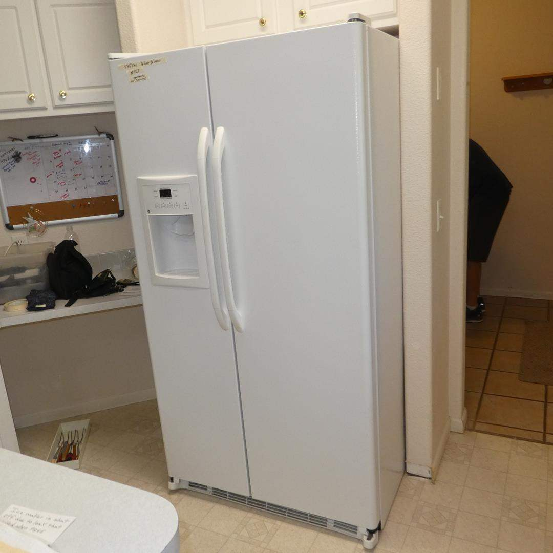 Lot # 133 - General Electric Company Side by Side Refrigerator/Freezer & Water Filters (main image)