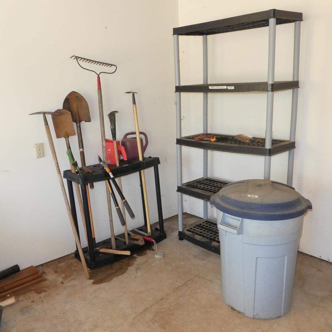 Lot # 140 - Yard Tools in Holder, Plastic Storage Shelf & Garbage Can (main image)