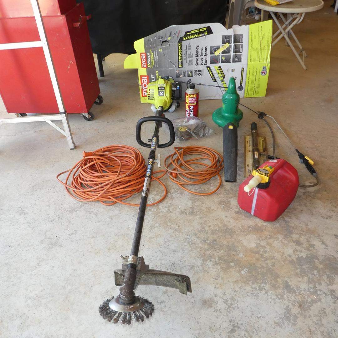 Lot # 142 - Ryobi 2 Cycle Gas String Trimmer (New), Extension Cords, Electric Blower & Pressure Washer Gun