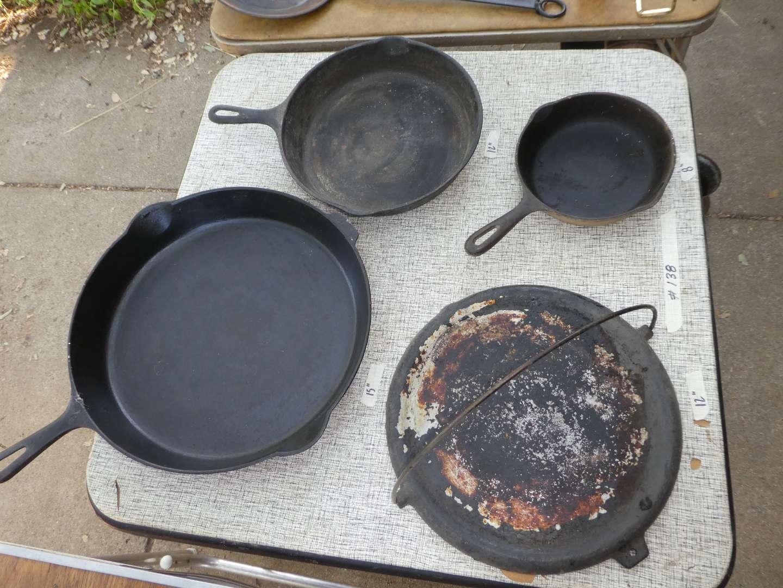 Lot # 138 - Beautiful Large Cast Iron 15''in Pan, Aluminum Griddle & 2 Smaller Cast Iron Pans (main image)