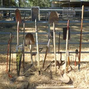 Lot # 3 - Yard Tools - Shovels, Hand Saws, Axes, Hay Fork, Shovels/ Rake Heads, Extra Sticks and More