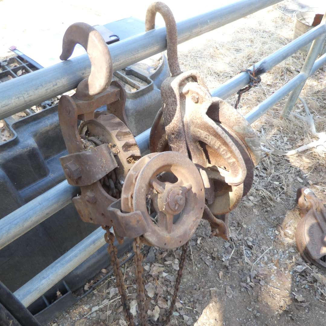 Lot # 7 - Two Vintage Cast Iron Pulleys  (main image)