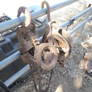 Lot # 7 - Two Vintage Cast Iron Pulleys