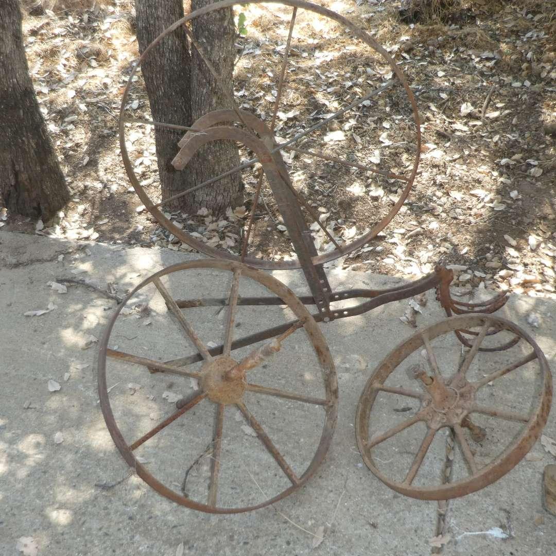 Lot # 18 - Vintage Metal Wheels, Vintage Primitive Plow (Missing Handles) and Fire Place Tools  (main image)