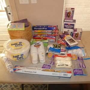 Lot # 234 - Paper Plates, Wicker Plate Holders, Plastic Utensils, Plastic Baggies, Aluminum Foil, Plastic Wrap and More
