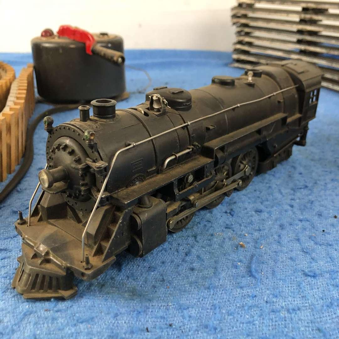 Lot # 63 - Vintage Lionel O Gauge Train and Track (main image)