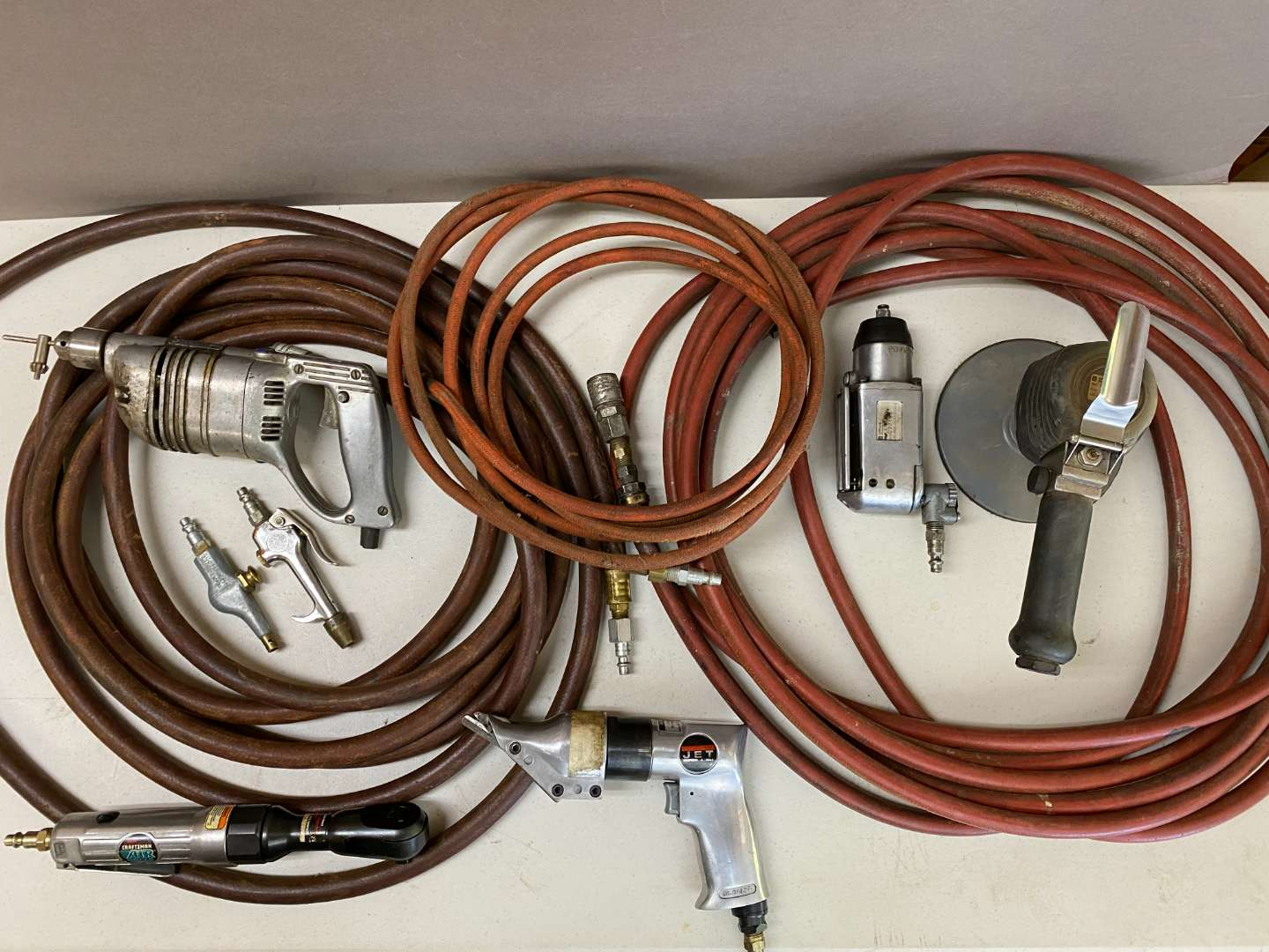 Lot # 127 - Large lot of air tools and accessories (main image)