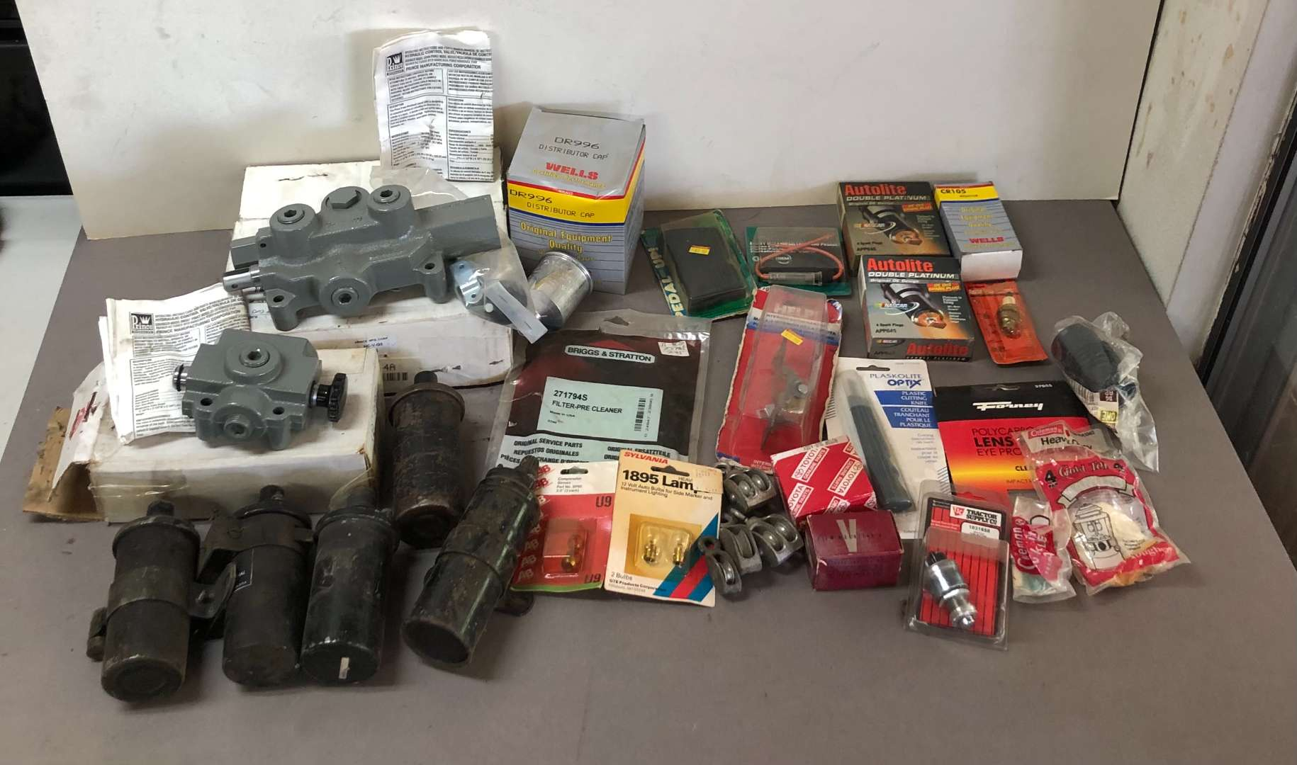 Lot # 257 - Lot of Spark Plugs, Hydraulic Control Valves and More (main image)