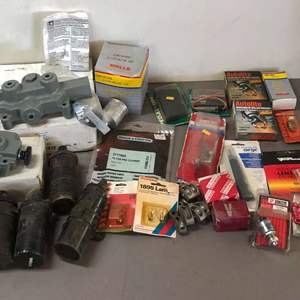 Lot # 257 - Lot of Spark Plugs, Hydraulic Control Valves and More