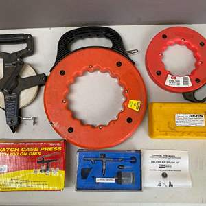 Lot # 123 - Lot of Tools Electrical Snakes, Tape Measure and More