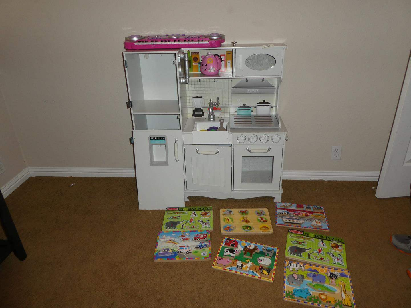 Lot # 81 - Kids' Play Kitchen Set, Melissa & Doug Hand Crafted Sound Puzzles & Magnetic Butterflies Wall Decor (main image)