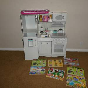 Lot # 81 - Kids' Play Kitchen Set, Melissa & Doug Hand Crafted Sound Puzzles & Magnetic Butterflies Wall Decor