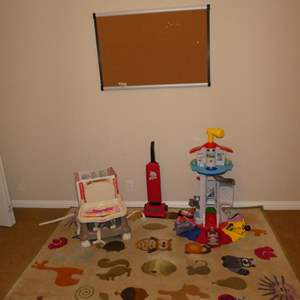 Lot # 83 - Kids Animal Throw Rug, Bulletin Board, Fisher Price Deluxe Booster Seat, Toy Vacuum & Play Set