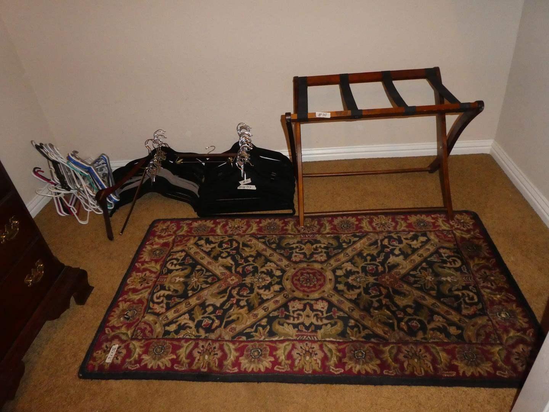 Lot # 70 - 70+ Clothes Hangers, Folding Luggage Rack & Wool Throw Rug (main image)