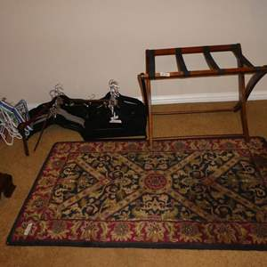 Lot # 70 - 70+ Clothes Hangers, Folding Luggage Rack & Wool Throw Rug