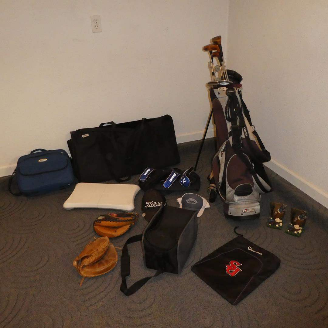 Lot # 99 - Assorted Golf Clubs, Golf Club Carrier, Catchers Mitts, Wii Balance Board, Sleeping Bag & Folding Poker Table (main image)